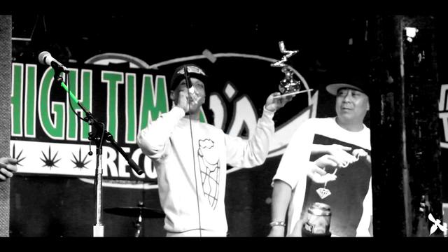 DJ Babu Presents Curren$y With High Times Award